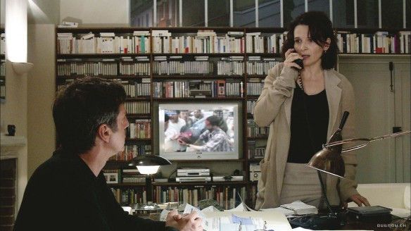Juliette Binoche gets a call from the library regarding overdue books.