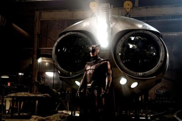 The Nite Owl stands before Archimedes, his high-tech flying machine.
