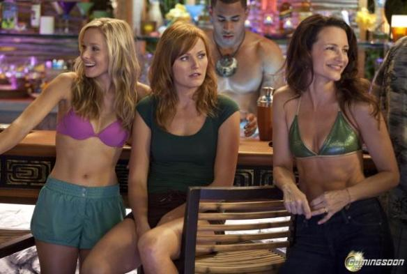 Malin Akerman (center) realizes her love scenes are with Vince Vaughn while her co-stars pretend not to notice her discomfort.