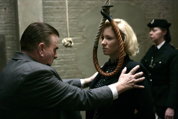 Timothy Spall fits Mary Stockley with a new fashion accessory.