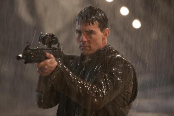 A picture guaranteed to please both men (big gun) and women (wet Tom Cruise).