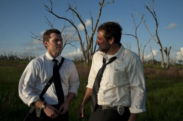 Jeffrey Dean Morgan lectures Sam Worthington on the virtues of unshaven sexiness.