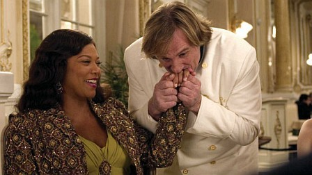 Gerard Depardieu missed lunch but Queen Latifah lets him eat a finger or two.