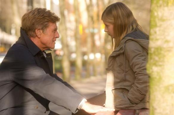 Robert Redford explains to Jackie Evancho who the Sundance Kid was.