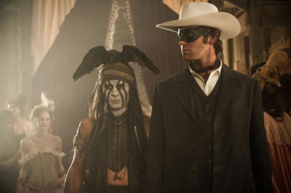 Armie Hammer isn't quite sure how to tell Johnny Depp he has a dead bird on his head.
