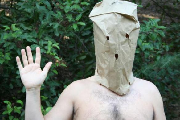 There's nothing creepier than a friendly half-naked guy with a paper bag over his head in the woods.