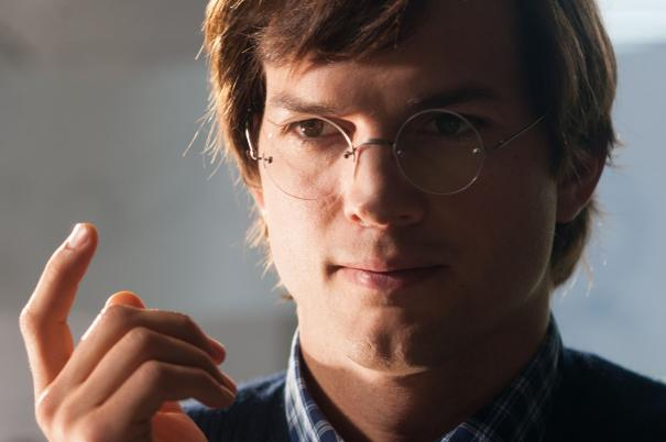 Ashton Kutcher counts the number of good reviews.
