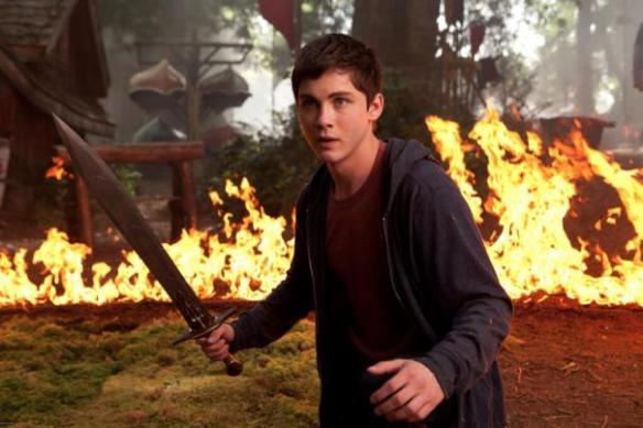 Logan Lerman, wearing his hoodie, keeps a sharp eye out for George Zimmerman.