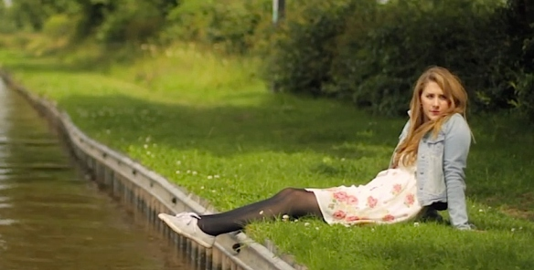 A beautiful girl on the bank of a canal - ah, English Spring!