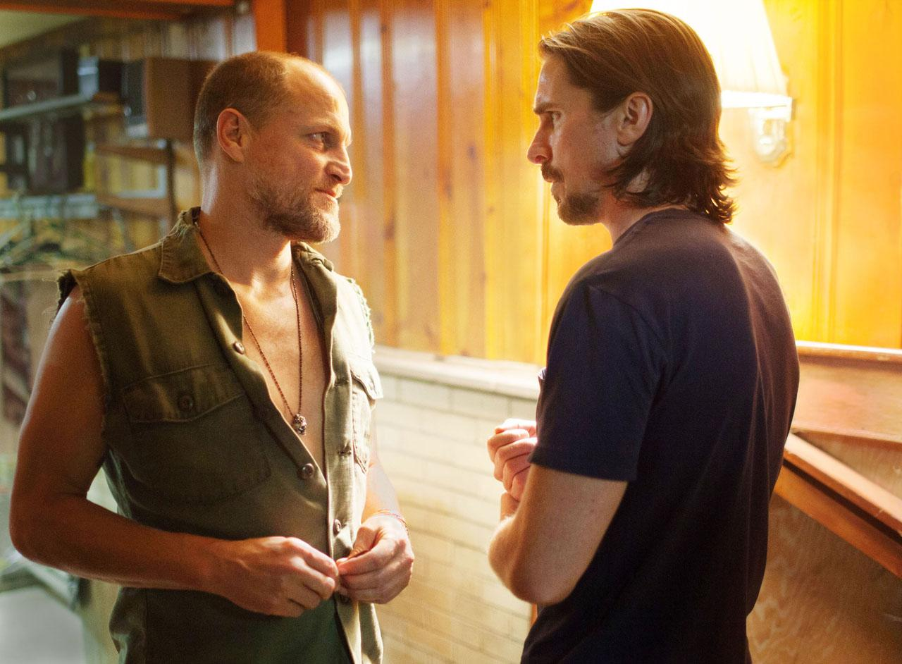 Woody Harrelson is perfectly willing to take off his shirt for Christian Bale.