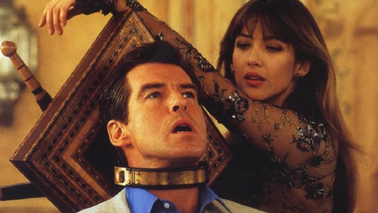 Sophie Marceau thinks Pierce Brosnan looks fetching in this choker.