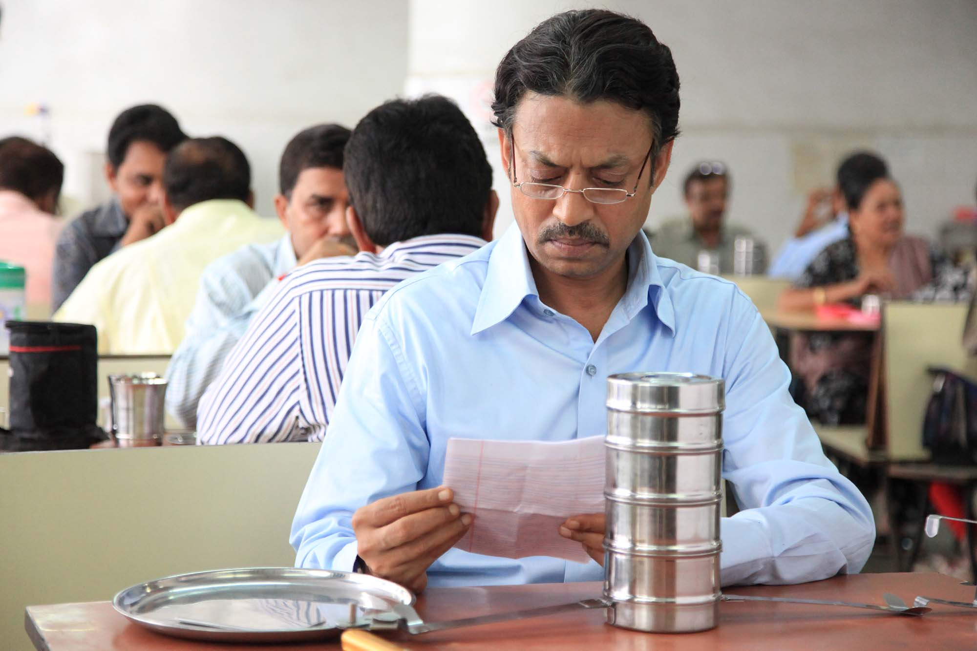 Irrfan Khan reads his fan mail.