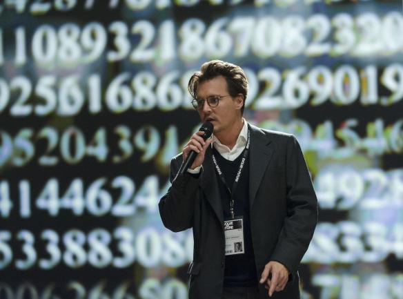 Johnny Depp's salary for the film is displayed behind him.
