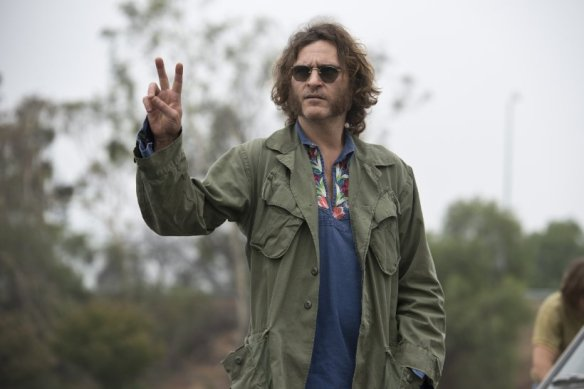 Joaquin Phoenix counts the number of people in the theater.
