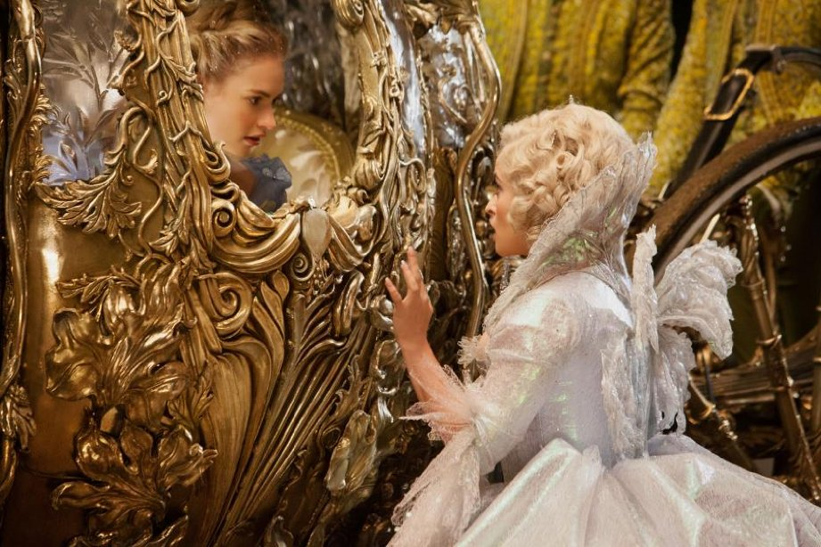 Cinderella in pumpkin coach with fairy godmother.