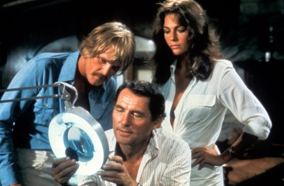 Nick Nolte, Robert Shaw and Jacqueline Bisset in drier clothes.