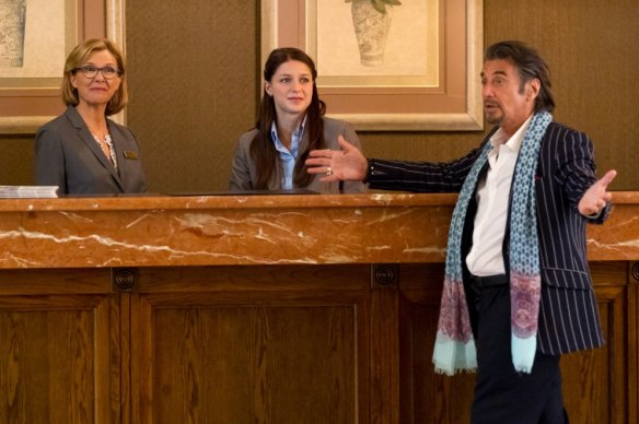 Pacino describes the size of his paycheck as a bemused Bening and Benoist look on.