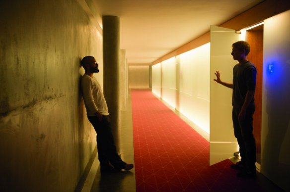 Domhnall Gleeson holds open a door but Oscar Isaac one-ups him by holding up a wall.