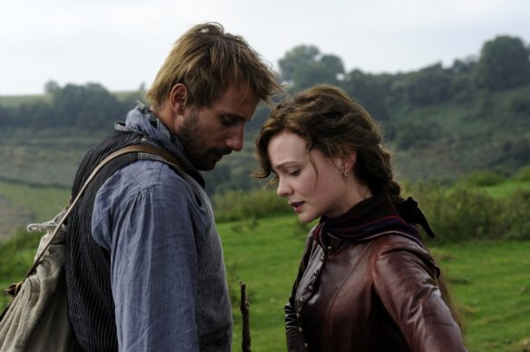 Matthias Schoenaerts and Carey Mulligan nuzzle in the Dorset countryside.