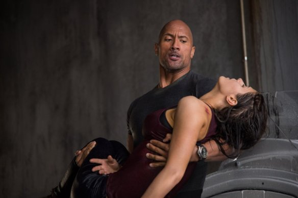 Either The Rock is striking a heroic pose or he accidentally gave this girl The People's Elbow.