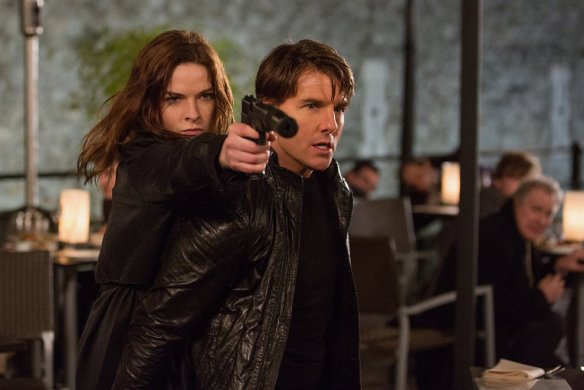Tom Cruise is within earshot of Rebecca Ferguson.