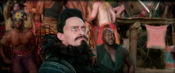 Hugh Jackman glares at his hair stylist.