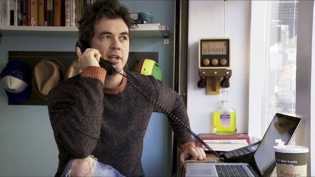 Jon J. Whelan works the phones.