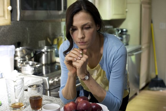 Famke Janssen prays for strength.