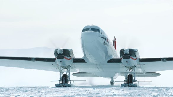 A DC-3 brings personnel and supplies to an Antarctic research station.