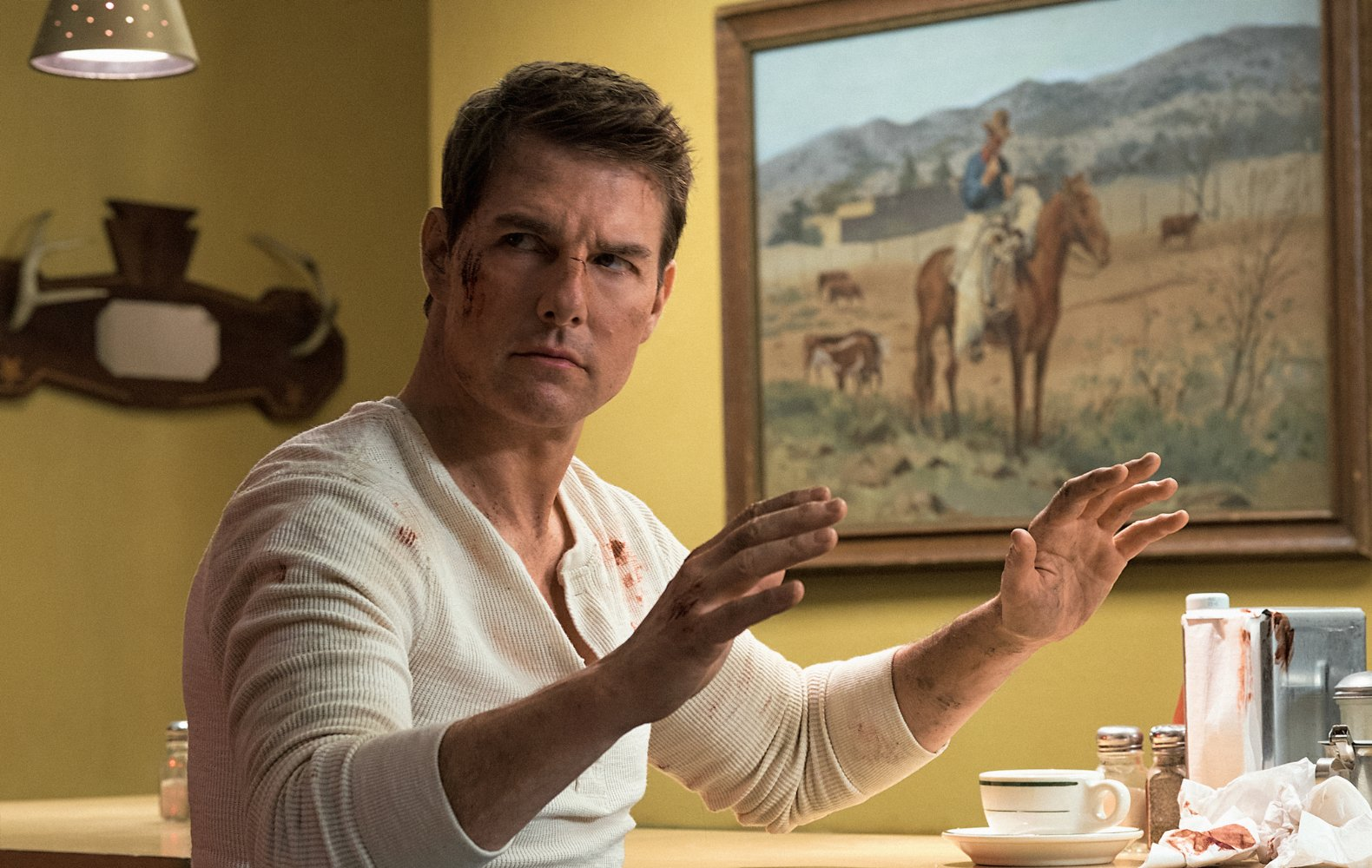 """Tom Cruise finds his """"make the ketchup bottle disappear"""" trick didn't work as well as expected."""