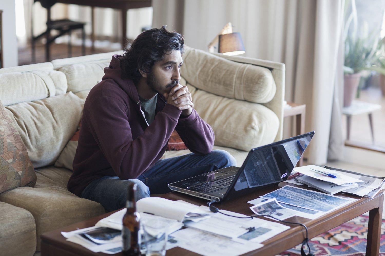 Dev Patel contemplates the blue screen of death.